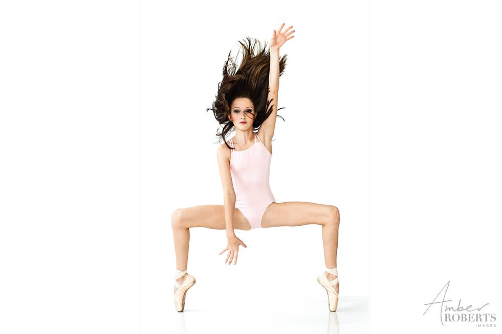 young dancer in contemporary dance pose