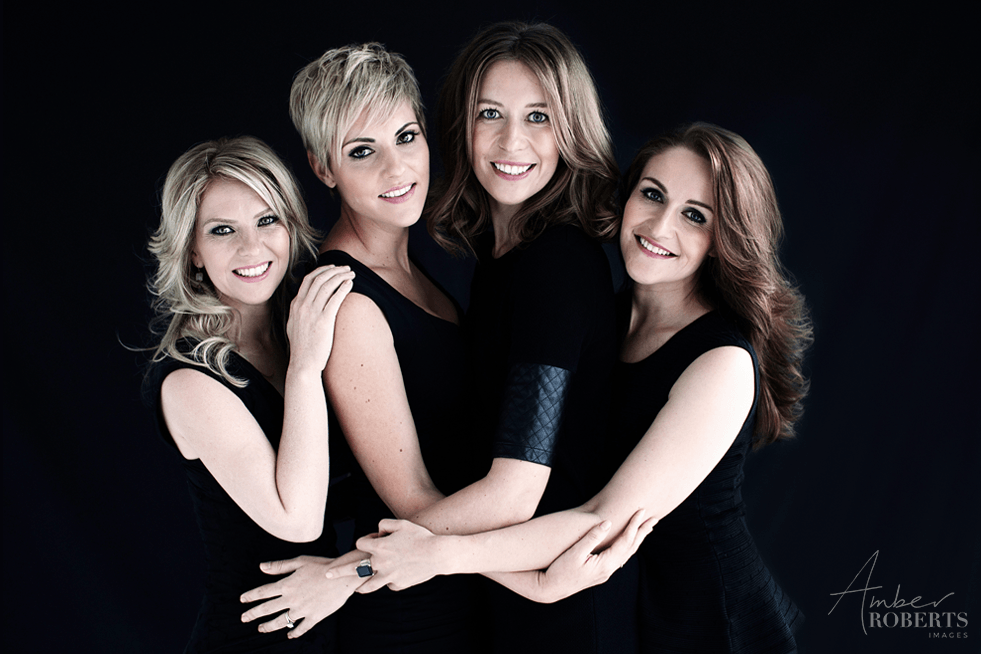 4 girlfriends hug in elegant photo shoot