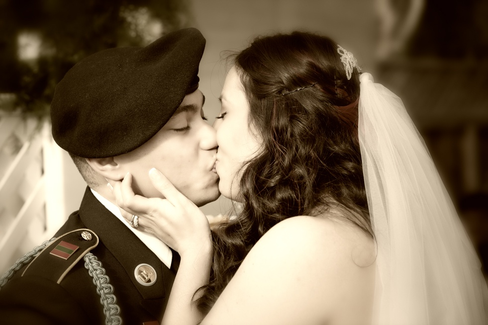 couple kissing at marriage ceremony
