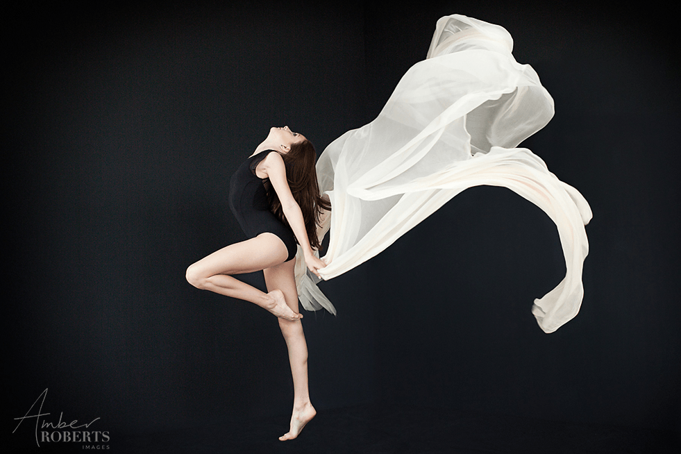 Young contemporary dancer with white silk