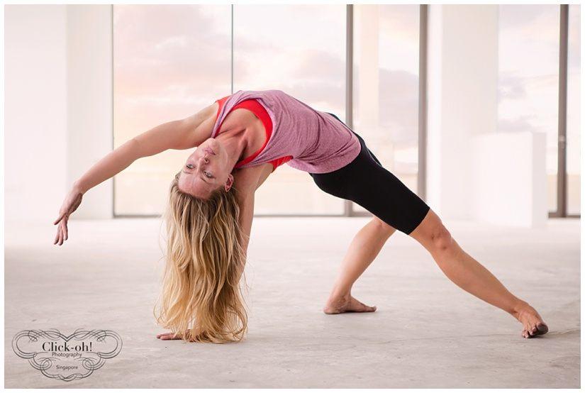model holds yoga pose