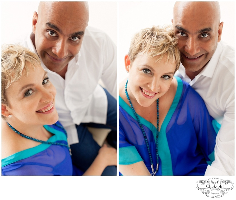 couple sits together against backlight in couples photo session