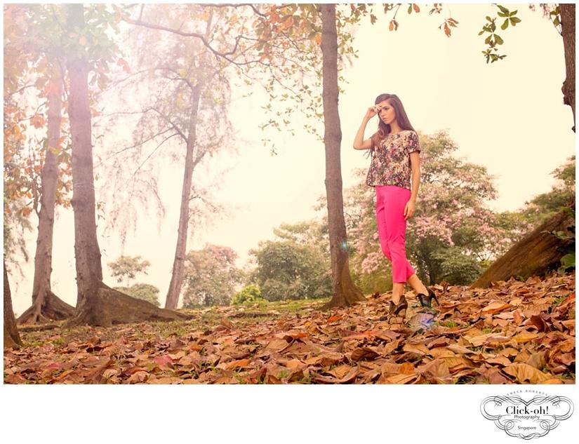 model poses in fallen leaves