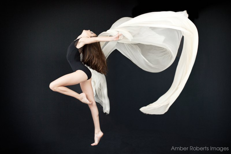 senior photo shoot in modern dance pose with white silk minneapolis