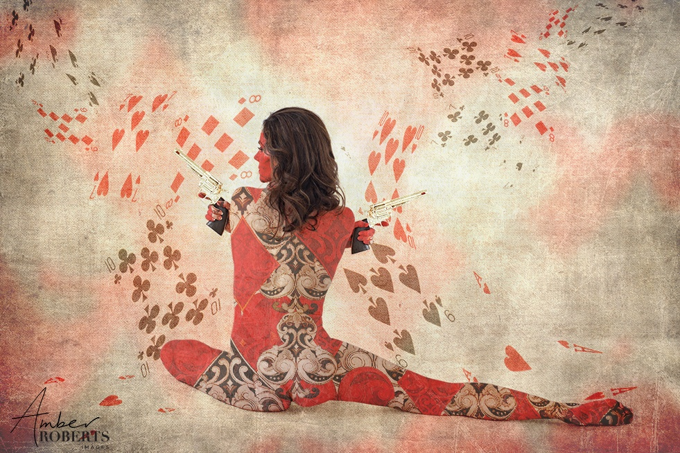 Composite Image of woman in style of Casino Royale bond girl with a skin of playing cards.